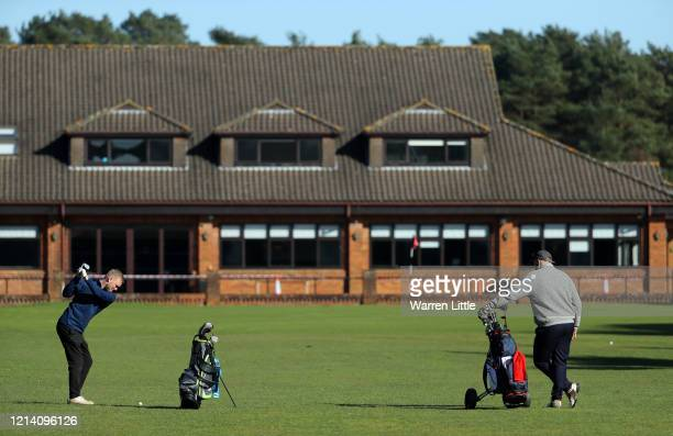 Golfers play at Pine Ridge Golf Club on March 22 2020 in Camberley England Coronavirus has spread to at least 188 countries claiming over 13000 lives...