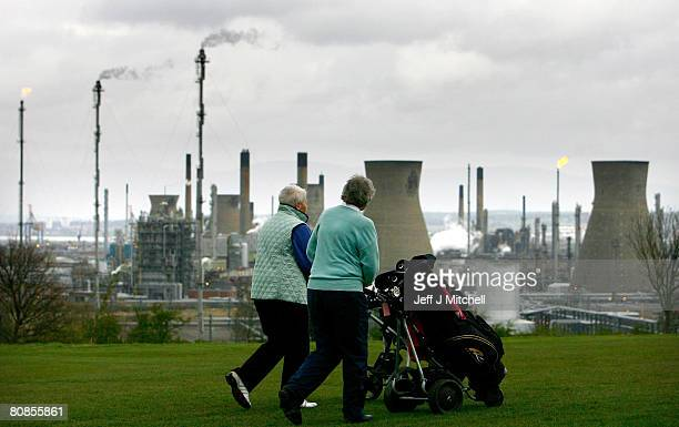 Golfers play at the Polmont golf club next to Grangemouth Oil Refinery April 25 2008 in Edinburgh Scotland Workers at the plant are to take part in a...