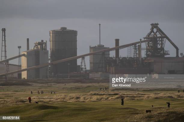 Golfers play in front of the former SSI Steel making plant on February 8 2017 in Redcar United Kingdom The SSI steel making plant at Redcar was...
