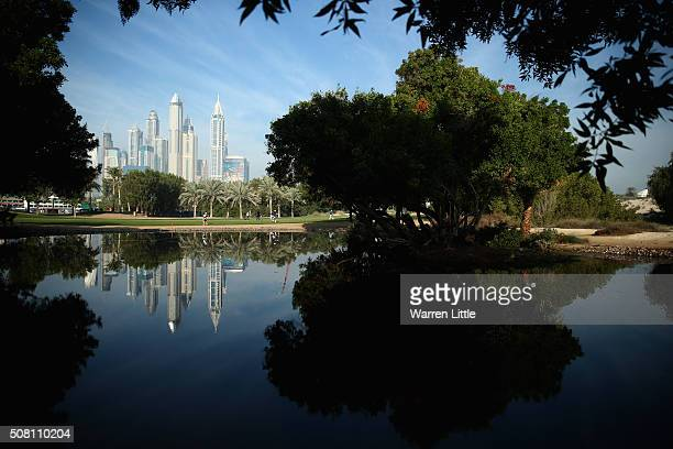 Golfers play the 12th hole during the proam event prior to the Omega Dubai Desert Classic on the Majlis course at the Emirates Golf Club on February...