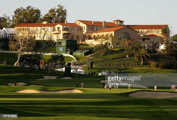Golfers play the ninth hole beneath the clubhouse during the first round of the Northern Trust Open on February 14, 2008 at Riviera Country Club in...