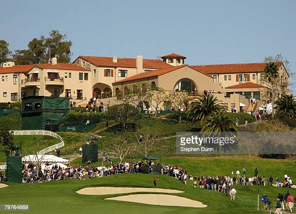 Golfers play the ninth hole beneath the clubhouse during the first round of the Northern Trust Open on February 14 2008 at Riviera Country Club in...