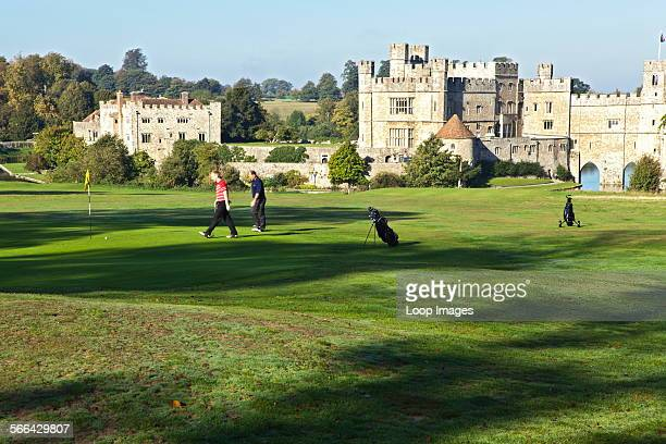 Golfers playing on the course at Leeds Castle.
