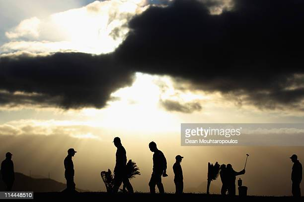 Golfers practice on the putting green as the sun rises before day two of the Madeira Islands Open on May 20 2011 in Porto Santo Island Portugal