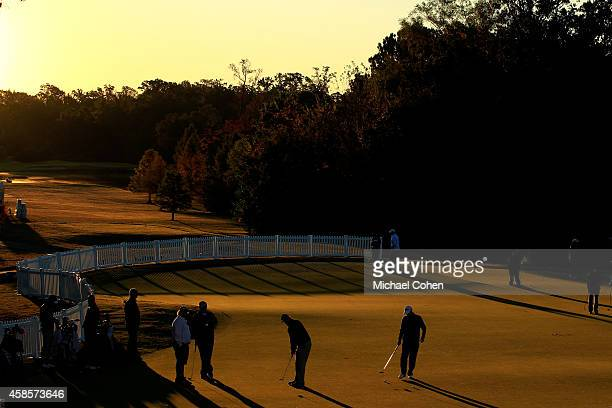 Golfers practice on the putting green prior to the start of round two of the Sanderson Farms Championships at The Country Club of Jackson on November...