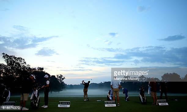 Golfers practice on the range prior to the start of play during the First Round of the Sanderson Farms Championship at the Country Club of Jackson on...