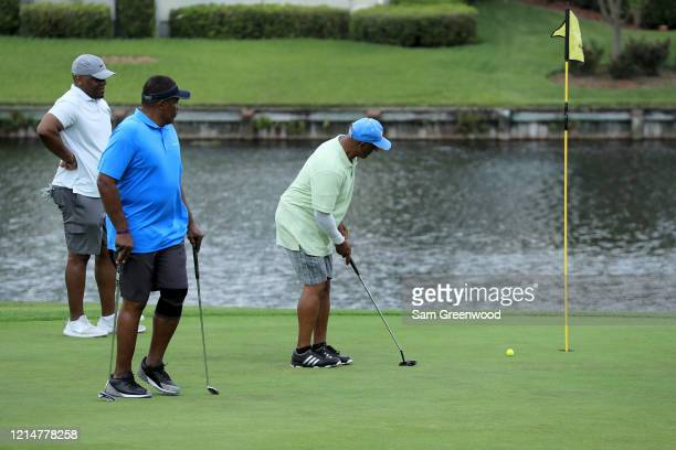 Golfers practice social distancing at Windsor Parke Golf Club amid the Coronavirus outbreak on March 25 2020 in Jacksonville Beach Florida The World...