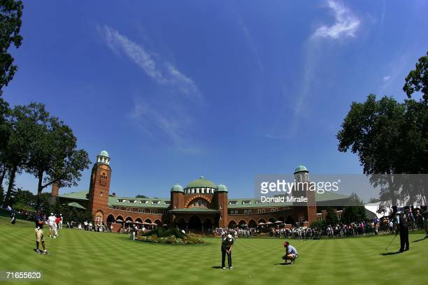 Golfers putt in front of the club house during practice for the 2006 PGA Championship at Medinah Country Club on August 16 2006 in Medinah Illinois