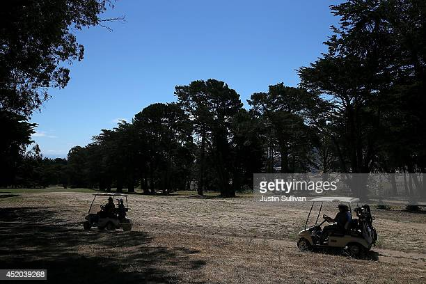 Golfers ride in golf carts next to dry grass on a fairway at Gleneagles Golf Course on July 11, 2014 in San Francisco, California. As the severe...