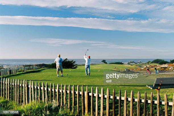 Golfers Tee Off on Monterey California ocean front Golf Course