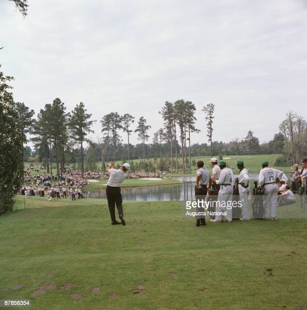 Golfers tee off on the eighth tee on the Par 3 Course during the 1965 Masters Tournament at Augusta National Golf Club in April 1965 in Augusta...