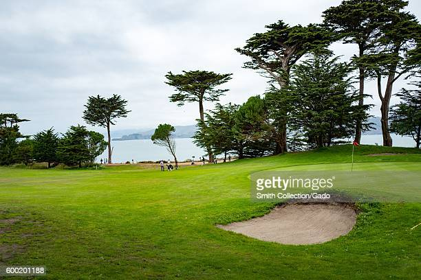 Golfers tee up on a golf course overlooking the San Francisco Bay at Eagle Point in the Lands End neighborhood of San Francisco California August 27...