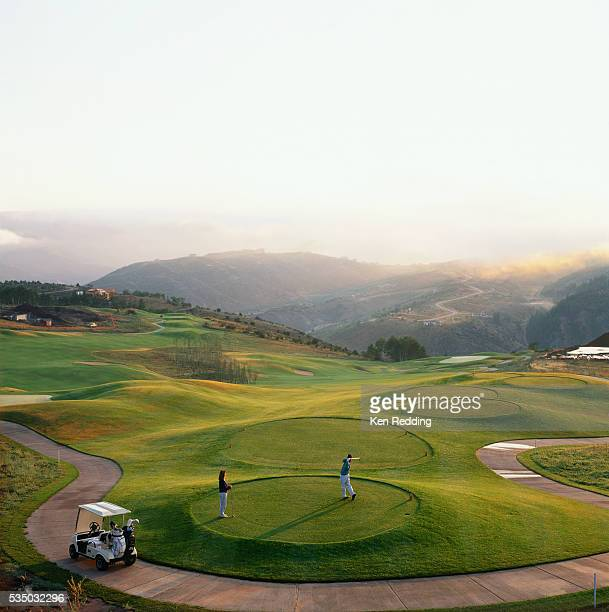 golfers teeing off at sunrise - teeing off stock pictures, royalty-free photos & images