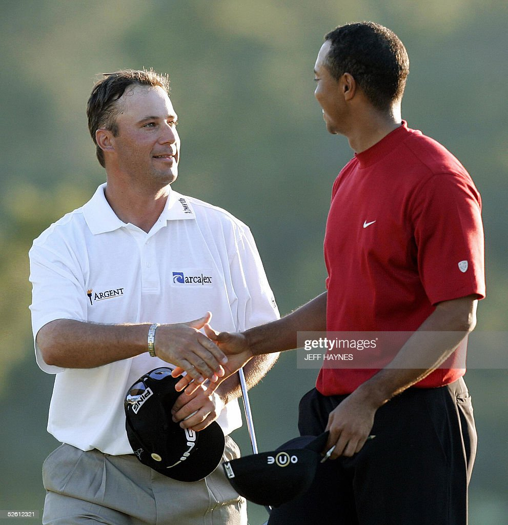 US golfers Tiger Woods (R) and Chris DiMarco shake hands at the end of regulation play at the 2005 Masters Golf Tournament Championship 10 April 2005 at the Augusta National Golf Club in Augusta, Ga. Woods claimed his 4th Masters title by defeating Chris DiMarco in a one-hole play-off. AFP PHOTO/Jeff HAYNES