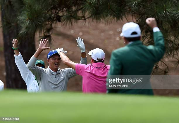 US golfers US golfer Rickie Fowler and Justin Thomas celebrate during the Par 3 contest prior to the start of the 80th Masters of Tournament at the...