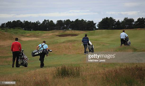 Golfers walk down the 5th green during the Virgin Atlantic PGA National ProAm Championship Regional Final at Dundonald Links on July 28 2011 in...