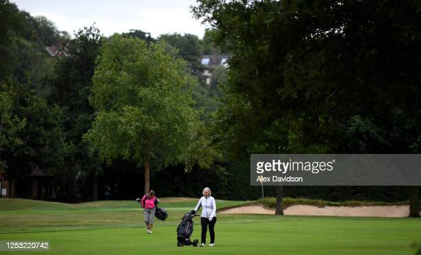 Golfers walk down the fairway at Wimbledon Golf Club which would normally be used as a car park on June 29 2020 in Wimbledon England The Wimbledon...
