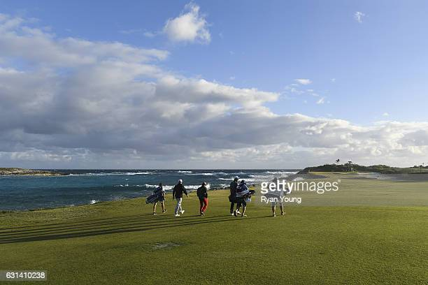 Golfers walk up the 12th fairway during the continuation of the second round of The Bahamas Great Exuma Classic at Sandals Emerald Bay Course on...