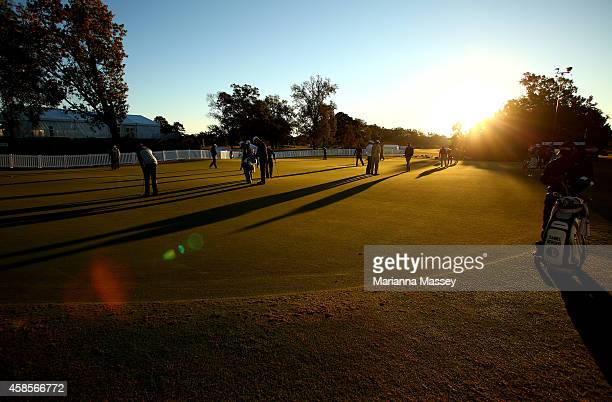 Golfers warm up on the putting green prior to round two of the Sanderson Farms Championship at The Country Club of Jackson on November 7 2014 in...