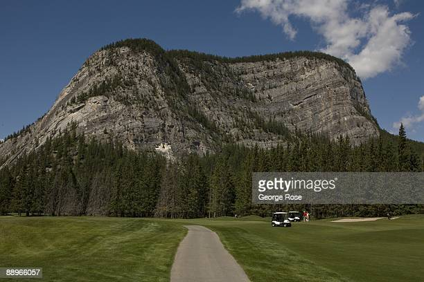 Golfers work their way along the wide green fairways at the Fairmont Banff Springs course as seen in this 2009 Banff Springs Canada summer afternoon...