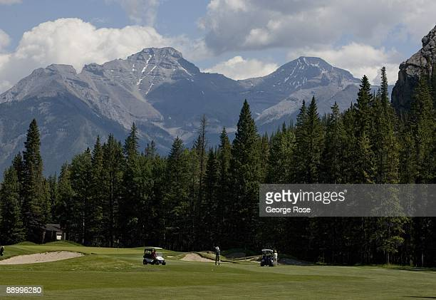 Golfers work their way along the wide green fairways at the Fairmont Banff Springs golf course as seen in this 2009 Banff Springs Canada summer...