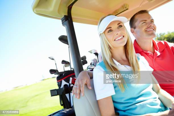 Golfing couple in their golf cart