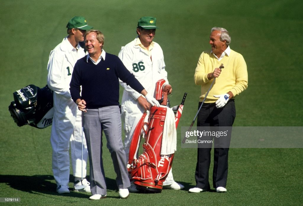 Golfing legends Jack Nicklaus and Arnold Palmer of the USA share a joke during the US Masters on April 9, 1987 at Augusta National Golf Club in Augusta, Georgia.