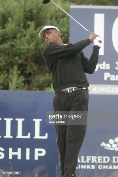 Golfing superstar Vijay Singh follows his ball down the middle of the tenth after a monstor drive.