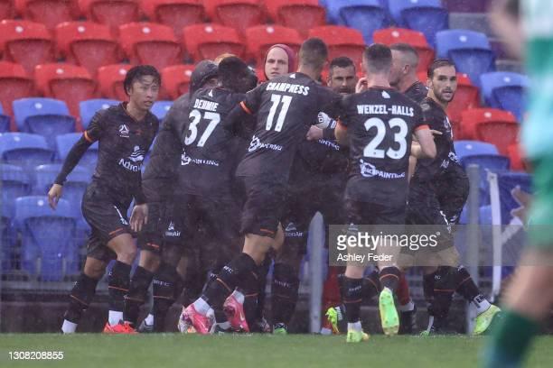 Golgol Mebrahtu of Brisbane Roar celebrates his goal with team mates during the A-League match between the Wellington Phoenix and the Brisbane Roar...