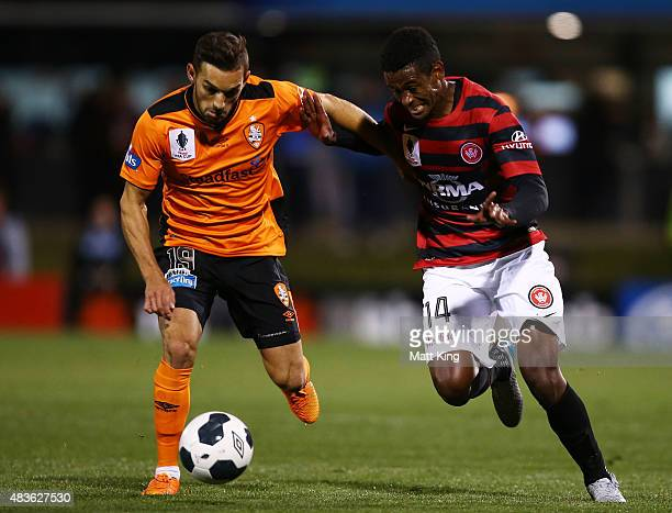 Golgol Mebrahtu of the Wanderers is challenged by Jack Hingert of the Roar during the FFA Cup match between Western Sydney Wanderers and Brisbane...