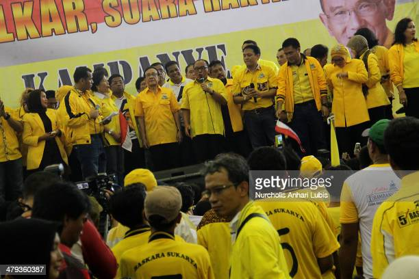 Golkar Party chairman Aburizal Bakrie who is also the partys presidential candidate waves during his campaign on March 18 2014 in Jakarta Indonesia...