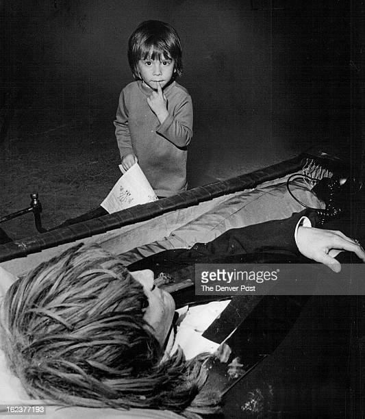 OCT 23 1975 'Golly I Guess I'm Scared' Jordan Friedlander is undecided as he looks over a corpse in a coffin in the Haunted House a part of A Museum...