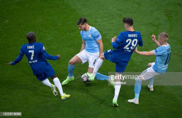 Golo Kanté and Kai Havertz of Chelsea take on Rúben Dias and Oleksandr Zinchenko of Manchester City during the UEFA Champions League Final between...