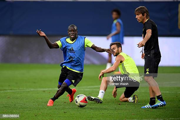 Golo Kante and Antonio Conte of Chelsea during a training session at the US Bank Stadium on August 2 2016 in Minneapolis Minnesota