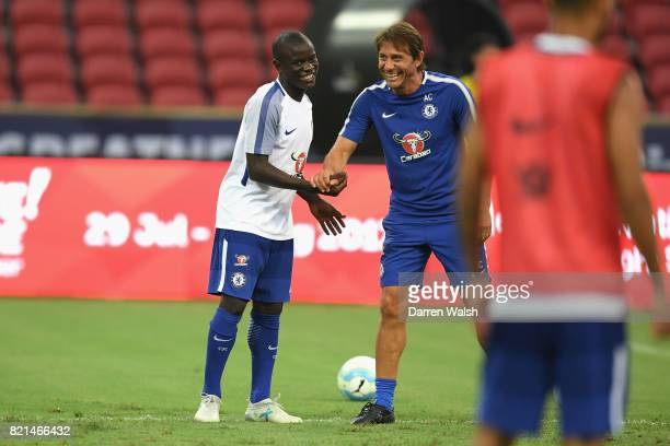 Golo Kante and Antonio Conte of Chelsea during a training session at Singapore National Stadium on July 24 2017 in Singapore