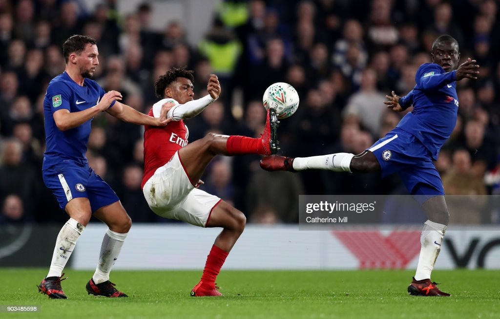 N'Golo Kante and Danny Drinkwater of Chelsea tackles Alex Iwobi of Arsenal during the Carabao Cup Semi-Final First Leg match between Chelsea and Arsenal at Stamford Bridge on January 10, 2018 in London, England.