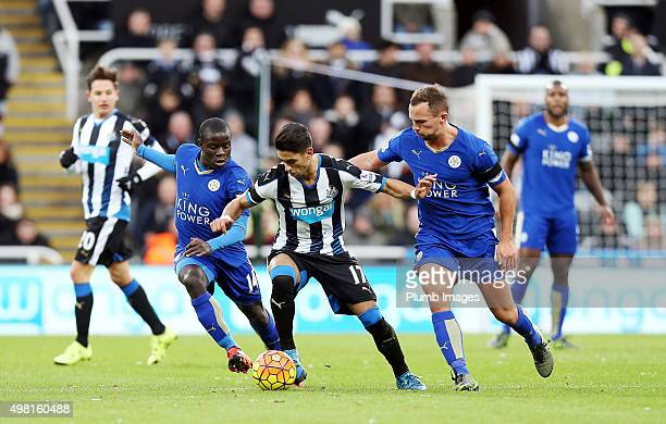 N'Golo Kante and Danny Drinkwater of Leicester City close down Ayoze Perez of Newcastle United during the Premier League match between Newcastle...