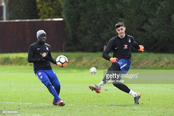 Golo Kante and Thibaut Courtois of Chelsea during a training session at Chelsea Training Ground on March 16 2018 in Cobham United Kingdom