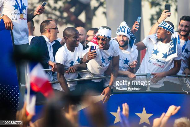 Golo Kante, Djibril Sidibe, Nabil Fekir, Hugo Lloris, professional football players, attend the France's World Cup Winning Team Parade Down The...