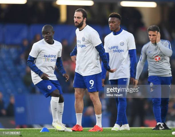 N'golo Kante Gonzalo Higuain and Callum HudsonOdoi of Chelsea warm up as Gianfranco Zola assistant manager of Chelsea looks on prior to the Premier...