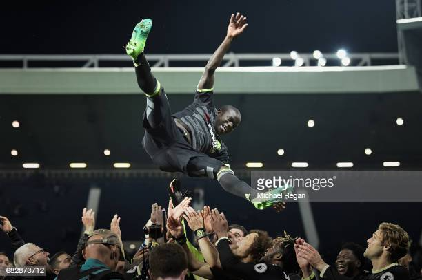 Golo Kante is thrown in the air by team mates as Chelsea celebrate winning the league after the Premier League match between West Bromwich Albion and...