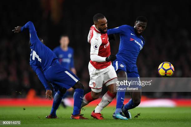 Golo Kante of Chelsea Alexandre Lacazette of Arsenal and Tiemoue Bakayoko of Chelsea battle for possession during the Premier League match between...