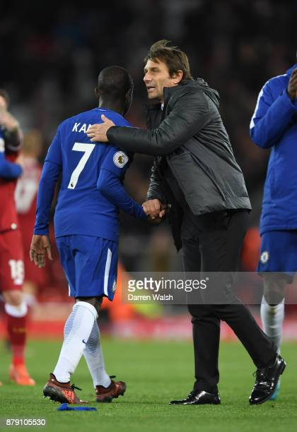 Golo Kante of Chelsea and Antonio Conte Manager of Chelsea embrace after the Premier League match between Liverpool and Chelsea at Anfield on...
