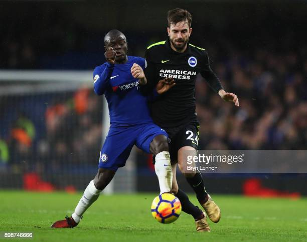 Golo Kante of Chelsea and Davy Propper of Brighton and Hove Albion battle for the ball during the Premier League match between Chelsea and Brighton...