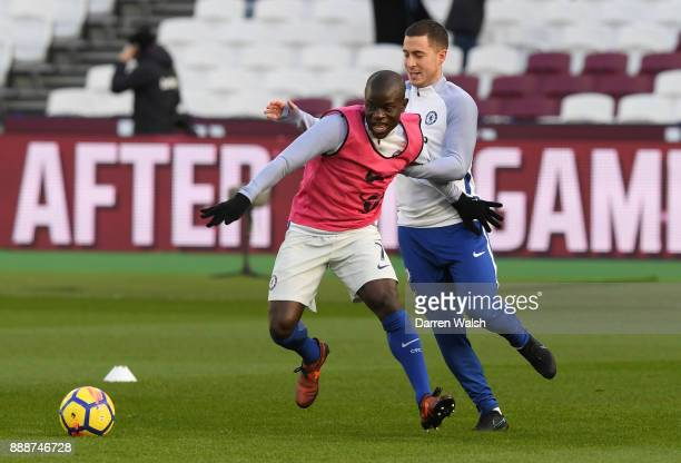 Golo Kante of Chelsea and Eden Hazard of Chelsea warm up prior to the Premier League match between West Ham United and Chelsea at London Stadium on...