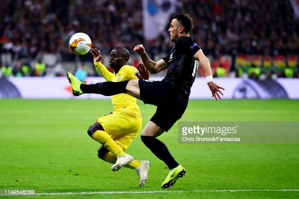 Golo Kante of Chelsea and Filip Kostic of Eintracht Frankfurt battle for the ball during the UEFA Europa League Semi Final First Leg match between...