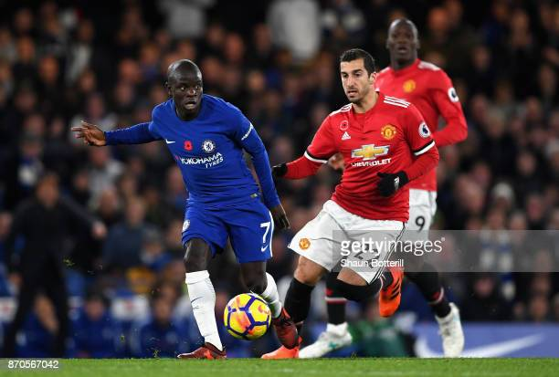 Golo Kante of Chelsea and Henrikh Mkhitaryan of Manchester United battle for possession during the Premier League match between Chelsea and...