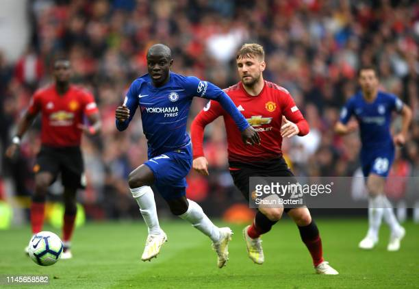 N'golo Kante of Chelsea and Luke Shaw of Manchester United chase the ball during the Premier League match between Manchester United and Chelsea FC at...
