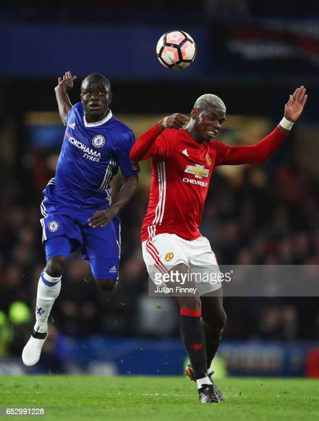 Golo Kante of Chelsea and Paul Pogba of Manchester United jump for the ball during The Emirates FA Cup QuarterFinal match between Chelsea and...