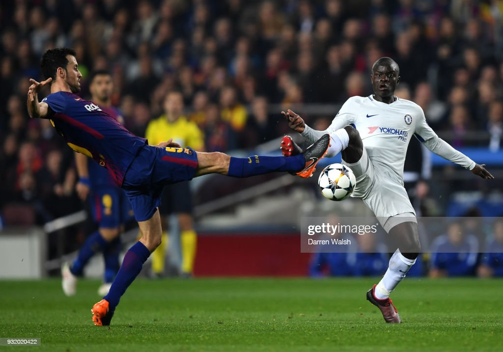 N'Golo Kante of Chelsea and Sergio Busquets of Barcelona battle for the ball during the UEFA Champions League Round of 16 Second Leg match FC Barcelona and Chelsea FC at Camp Nou on March 14, 2018 in Barcelona, Spain.